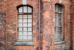 Two windows in a brick wall. Two arched windows in brick wall Stock Images