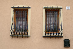 Two Windows of the building with bars Stock Photos