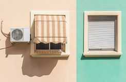 Two windows with colorful facade of a residential building Stock Image