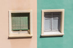 Two windows with colorful facade of a residential building Stock Photos