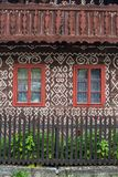 Two windows and decorative wall in Cicmany. Cicmany, Slovakia - august 02, 2015: Old wooden houses in Slovakia village Cicmany, traditional painted with white Royalty Free Stock Photography