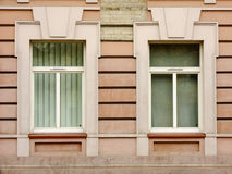 Two Windows. Two different Windows of old red Building Royalty Free Stock Image