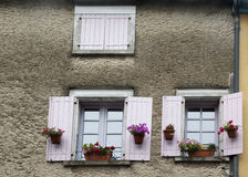 Two windows with flowers in Mirepoix France Royalty Free Stock Photography