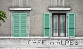 Two windows and green shutters royalty free stock image