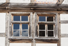 Two windows in a half timbered house Stock Image