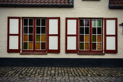 Two windows on the house in Bruges, Belgium. 2016 Royalty Free Stock Photo