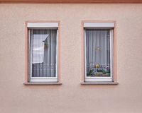 Two windows on light pink wall Stock Image