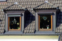 Two windows on mansard roof Royalty Free Stock Photography
