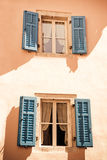 Two windows in Mediterranean style. With blue open blinds Stock Photography