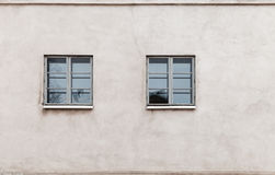 Two windows in modern gray concrete wall Royalty Free Stock Images