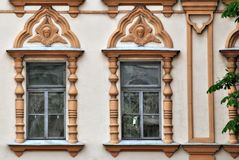 Two Windows with moldings. Royalty Free Stock Image