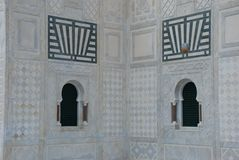 Two windows of mosque with fire alarm Royalty Free Stock Photo