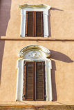 Two windows of an old classic building in Rome, Italy Royalty Free Stock Image