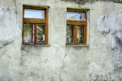 Two windows old clay wall Stock Photography