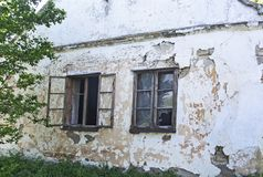 Windows of old abandoned house. Two windows on the old and devastated house royalty free stock photos