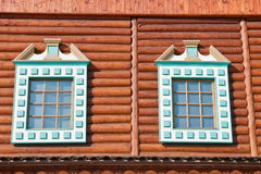 Two windows of old wooden house Stock Photos