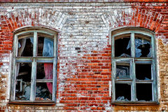 Two windows - one destiny. The house in the 19th century was built for housing of factory workers. In the 21st century residents were moved. Whether he will be Royalty Free Stock Photo