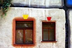 Two windows in organic facade Stock Image