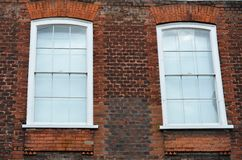 Two windows in red brick Stock Photo