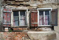Two windows in the ruin of a house Royalty Free Stock Photos