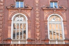 Two windows with shades and two without Royalty Free Stock Photos