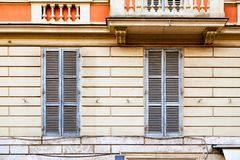 Two windows shut with blue shutters Royalty Free Stock Image