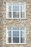 Two windows in a stone wall Royalty Free Stock Images