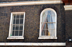 Two windows of a typical british building. Two windows of a typical british house, london Royalty Free Stock Photo