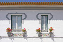 Two windows on a white wall background at algarve. South of Portugal Royalty Free Stock Images