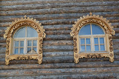 Free Two Windows With Wooden Carved Platbands On A Timbered Wall Royalty Free Stock Images - 60854559