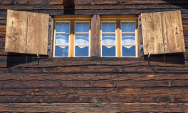 Two windows of a wooden hut Royalty Free Stock Image