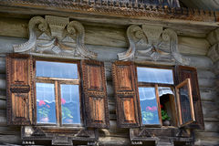 Two windows in an wooden peasant house Stock Image