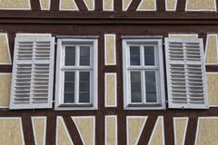 Two windows with wooden shutters Stock Image