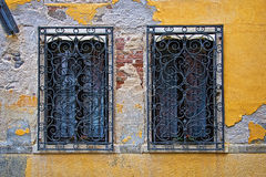 Two windows in a yellow old wall, Venice Stock Photography