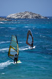 Two Windsurfer. Make a Competition in the greek Sea Royalty Free Stock Photography