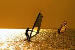 Two windsurfers stock image