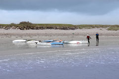 Two windsurfers finishing up after race and surf Royalty Free Stock Image