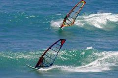 Two Windsurfers Windsurfing in Hawaii. Two windsurfers sailboarding near Diamond Head Beach Park in Hawaii Royalty Free Stock Photo