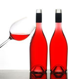 Two wine bottles and glass royalty free stock image