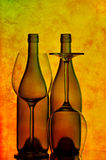 Two wine bottles and glasses. Silhouetted bottles of wine and glasses against grunge background Stock Images