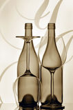 Two wine bottles and glasses. Silhouetted bottles of wine and glasses against graphic abstract background Stock Images