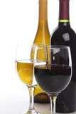 Two wine bottles with glasses Royalty Free Stock Images