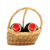 Two wine bottles on present basket isolated on white Royalty Free Stock Photography