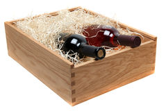 Two wine bottles in wooden case with wood-wool Stock Photos