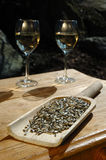 Two wine glass. In afternoon sunshine on the old wood table Royalty Free Stock Photos