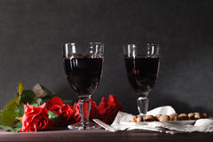 Two wine glass on dark table. With rose Stock Image