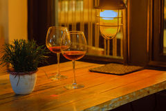 Two wine glass in night cafe, date concept Stock Image