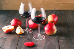 Two wine glass and red heart on wooden table Royalty Free Stock Images