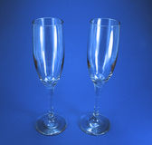 Two Wine Glasses. Wine galsses on  a blue background Royalty Free Stock Image