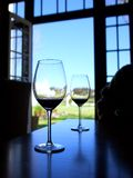 Two wine glasses against open door Royalty Free Stock Photo